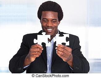 uomo affari, puzzle, jigsaw, presa a terra
