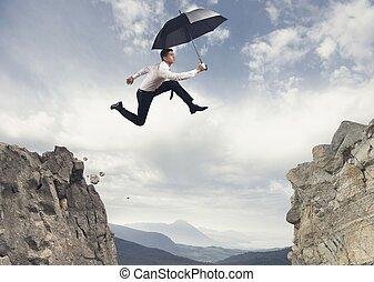 uomo affari, saltando, il, montagne