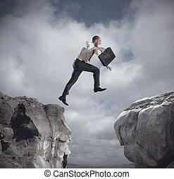 uomo affari, sopra, saltare, montagne