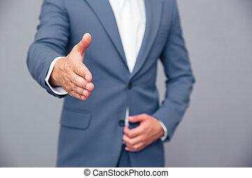 uomo affari, stiramento, mano, per, handshak