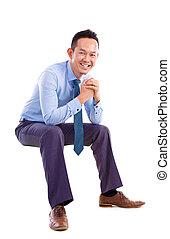 uomo asiatico, seduta, su, trasparente, sedia
