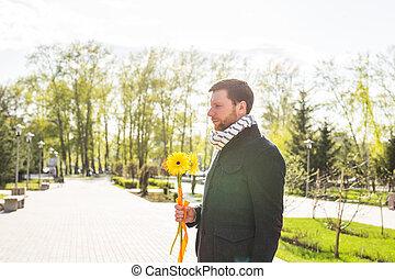 uomo, con, fiore, attesa, suo, donna, -, il, romantico, data, o, giorno valentines, concetto