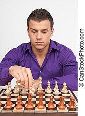uomo, gioco scacchi esegue, bianco, fondo., bello, giovane, spostamento, pezzo scacchi