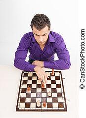 uomo, gioco scacchi esegue, bianco, fondo., vista superiore, su, di, giovane, spostamento, pezzo