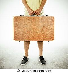 uomo, presa a terra, valigia