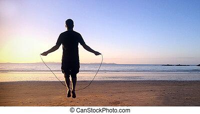 uomo, salti, su, corda salto, in, il, spiaggia