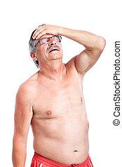 uomo senior, infelice, mal di testa