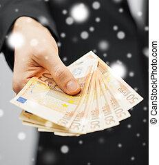 uomo soldi, contanti, euro, completo