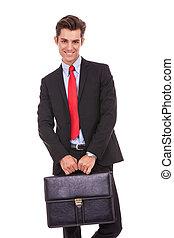 uomo sorridente, affari, valigia