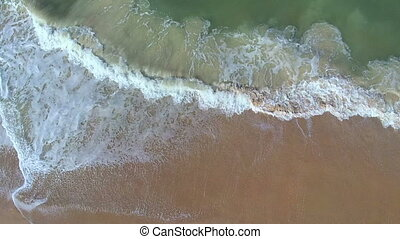 Up above the waves then zooming in - Drone shot on Canaveral...