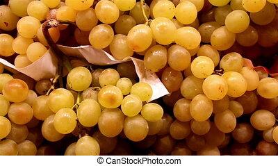 Up close image of the lots of yellow grapes big grapes