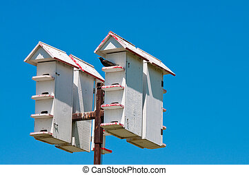 Up-close shot of bird houses