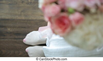 Up close up view of bride sitting holding bouquet in hands.