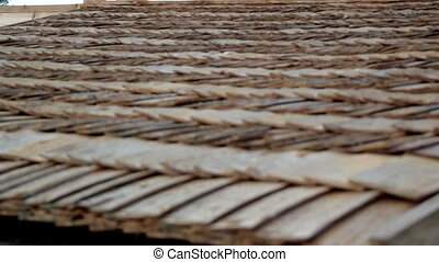Up-close view of the cabin wooden cedar shingle shake roof