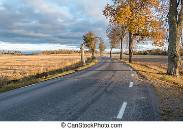 Up country road with a scenic landscape