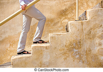 Person walking up the stairs