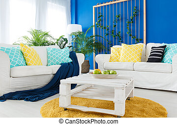 Up-to-date decor of spacious living room with white furniture