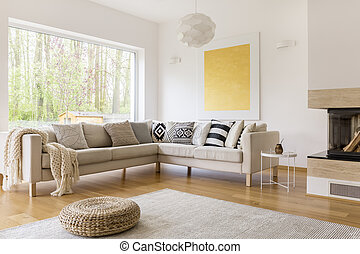 Up-to-date design of cozy spacious lounge with white sofa and carpet