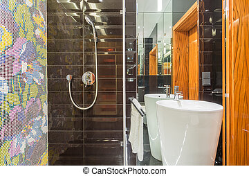 Up-to-date design of washroom with wooden door and colorful tiles