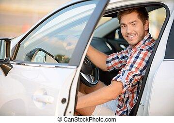 Upbeat boy sitting in the car