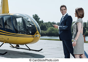 Upbeat businessman inviting his colleague for helicopter ride