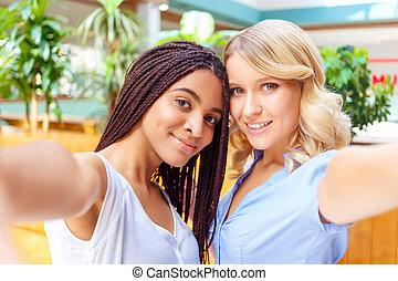 Upbeat girls making selfie
