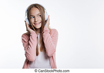 Upbeat teenage girl listening to music