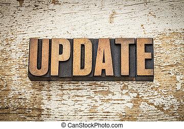 update word in vintage letterpress wood type on a grunge painted barn wood background
