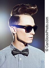 updo male hairstyle - Fashion studio shot of a handsome male...
