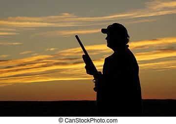 Upland Game Hunter at Sunset