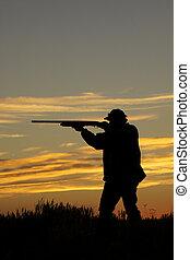 Upland Hunter Shooting in Sunset