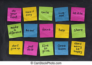 colorful sticky notes with uplifting and motiovational words of wisdom posted on blackboard with eraser smudges