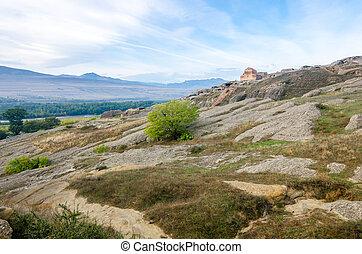 Uplistsikhe is an ancient rock-hewn town in eastern Georgia,...