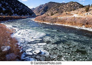 Upper Arkansas River in the Rocky Mountains of Colorado. Winter, ice floats on water