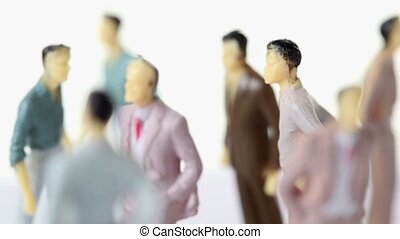 Upper body of several painted toy men is visible, all...