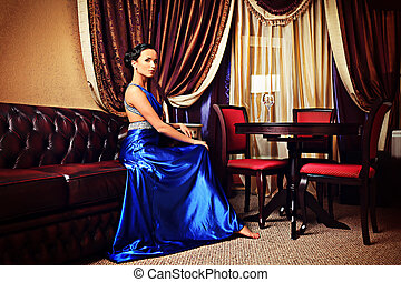 upper class - Beautiful young woman in a luxurious classic...