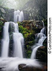 Upper Doyles River Falls on a foggy spring day in Shenandoah National Park, Virginia