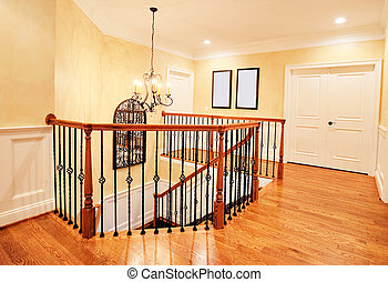 Upper Hallway and Staircase in Upscale Home - Interior of an...