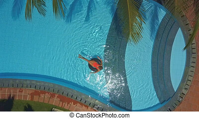 upper picture lady swims on ring in oval pool - pictorial...
