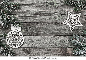 Upper, top, view from above of white winter figurines, evergreen branch on gray background, with space for text writing, greeting