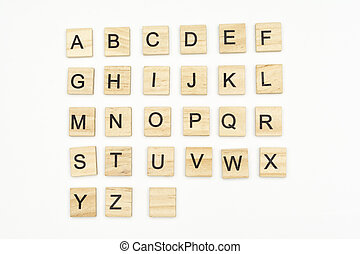 Uppercase alphabet letters on scrabble wooden blocks, isolated on white background
