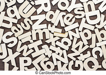 uppercase and lowercase wooden letters background on the table