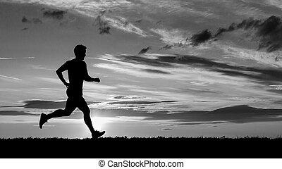 uprawiający jogging, wschód słońca