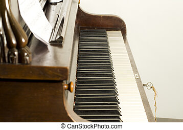 Original wooden upright piano with ivory keys