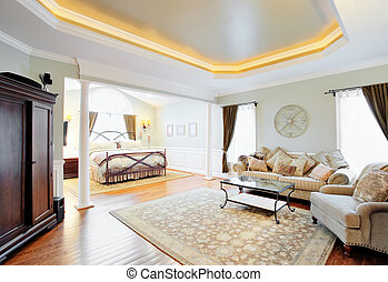 Upscale Master Suite Interior - View of a sitting area and ...