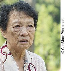 Upset Asian elderly woman