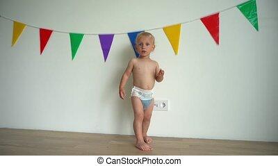 upset baby boy child wearing diaper showing negative...