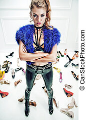 Upset blond woman with lots of shoes