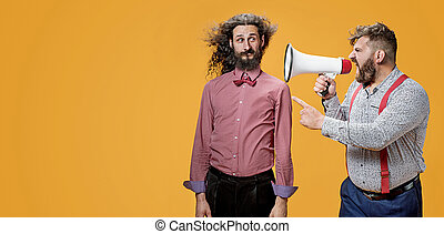 Upset boss yelling at his employee with a megaphone
