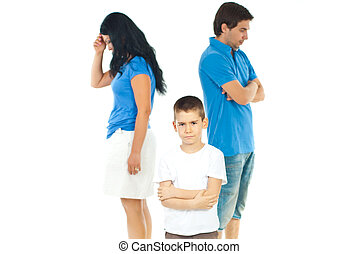 Upset boy standing with arms folded in front of parents with problems against white background